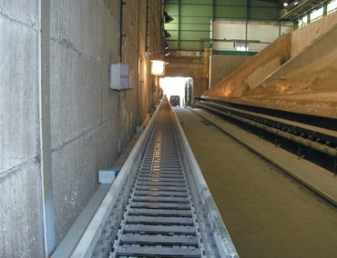 Long travel application in a bulk material stocker